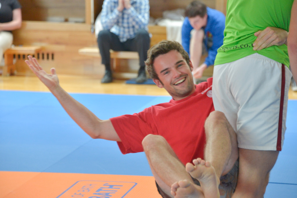 Cameron, a student ambassador helping in the Judo class