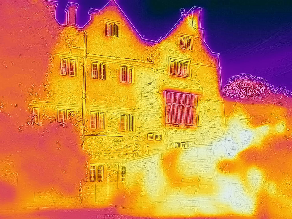 Infrared image of Cheney Court near Bath showing heat from sunlight radiating off stone walls.